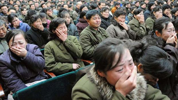 End of an era ...  North Koreans cry in Pyongyang.