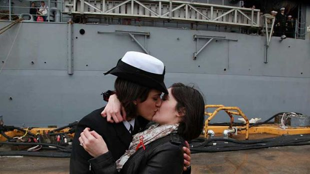 Petty Officer 2nd Class Marissa Gaeta, left, kisses her girlfriend of two years, Petty Officer 3rd Class Citlalic Snell ...