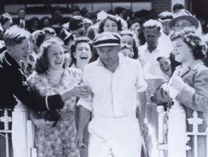 Don Bradman is applauded at the MCG for his testimonial match in 1948.