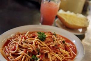 Crowd pleasers include the Spaghetti Napoli with parsley-laced sugo.