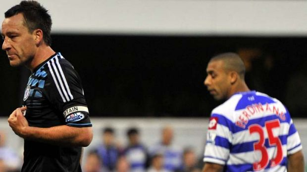Racial abuse claim ... QPR's Anton Ferdinand looks on as John Terry speaks with the referee (not pictured).