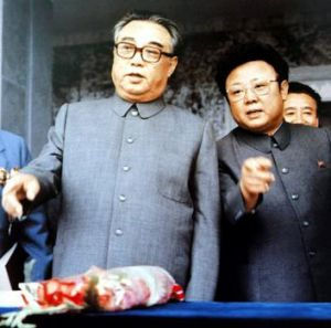 North Korea's founder, Kim Il-sung, chats to a younger Kim Jong-il at a 1983 rally in Pyongyang.