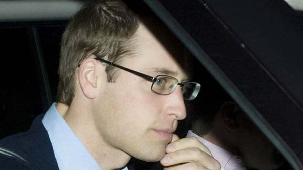 Hospital visit ... Britain's Prince William drives into Papworth Hospital to see his grandfather.