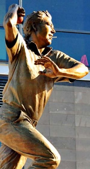Shane Warne's statue with a cigarette stuck in his mouth.