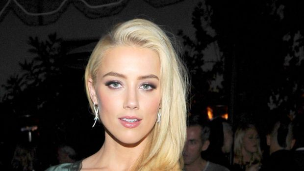 Silky simplicity ... Amber Heard's maximises her red carpet presence.