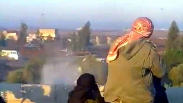 Ambush ... a video still shows purported members of the Free Syrian Army, made up of military defectors, firing a convoy ...