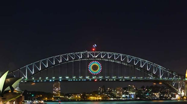 Isn't she pretty ... the light show test on the Harbour Bridge. Thousands of aerial shells and comets will be released ...