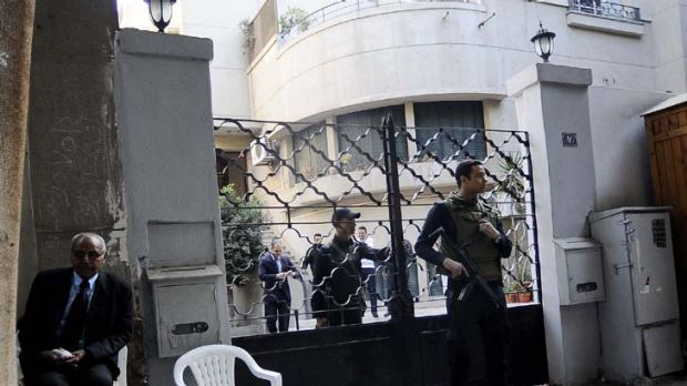 On guard ... Egyptian soldiers stand outside the US National Democratic Institute, an NGO in downtown Cairo.