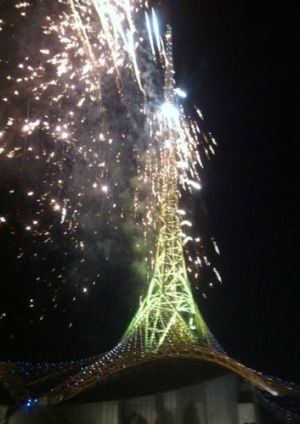The Arts Centre spire appears to catch on fire as fireworks are shot from the structure.