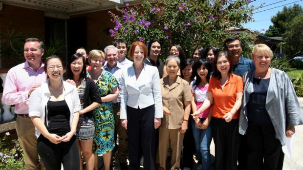 Julia Gillard (centre) and Jenny Macklin (right) with two families who would qualify for new tax breaks for families ...