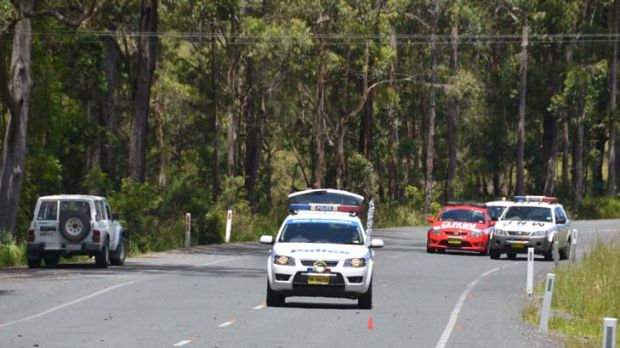 Inquiry ... the Nissan Patrol, left, involved in the death of two hitchhikers remains at the scene of the incident on ...