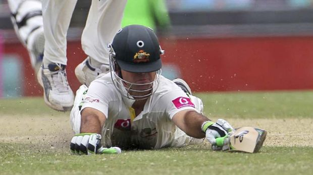 Close call: Ricky Ponting dives to make his ground to bring up his century.