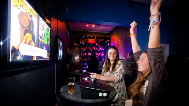 Jess Robb and Emily Newton get their game on at Mana Bar.