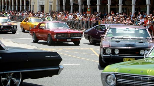 Start your engines: Spectators line Northbourne Avenue, Canberra, for the annual Summernats Citycruise of competitors.