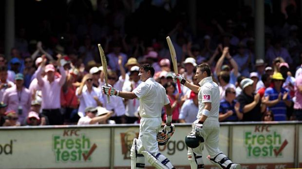 Michael Hussey and Michael Clarke return to the pavilion after Clarke declared the Australian innings at 4-659.