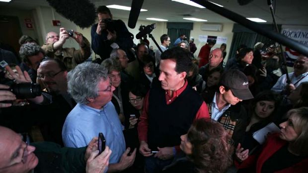 Rick Santorum talks to a voter in Brentwood, New Hampshire, his next campaign stop after his strong result in Iowa.