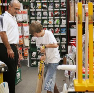 Harry Solomons advises Sam Lomax at the Kingsgrove store in a file picture.