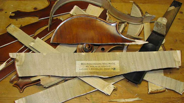 A picture the buyer of a violin sent to the selller, showing they had destroyed it.