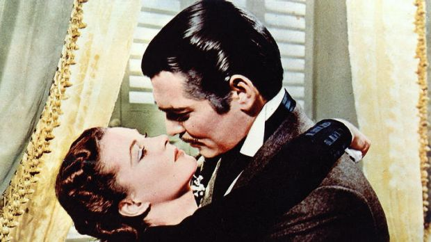 Rhett Butler played by Clark Gable and Scarlett O'Hara played by Vivien Leigh in the film of <i>Gone With The Wind</i>.