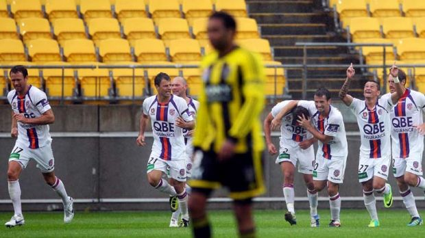 Glory players celebrate the goal against Wellington.