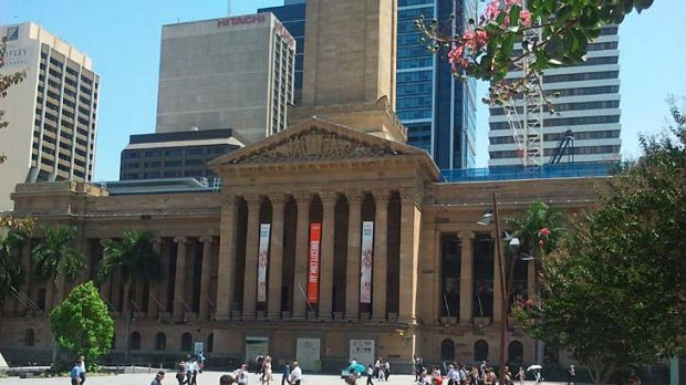 City workers wilt under the sun in King George Square.