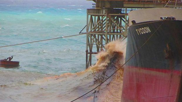 Oil spews from the 'Tycoon' docked at Christmas Island.