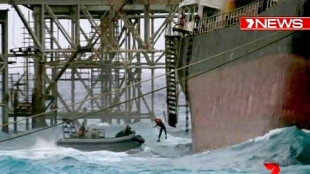 A crewman jumps into the sea as the MV Tycoon breaks up.