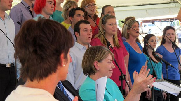 Premier Anna Bligh sits among the choir.