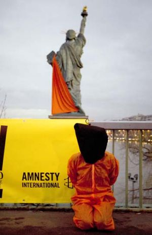 Amnesty activists protest against the camp this week.
