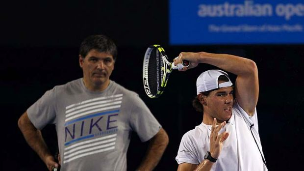 Rafael Nadal practises at Rod Laver Arena under the watchful eye of his uncle and coach, Toni Nadal.
