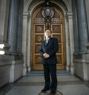 MP Hong Lim, outside Parliament, worries Chinese Australians are invisible in the country's politics.