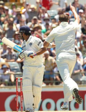 Peter Siddle celebrates dismissing Indian captain MS Dohni at the WACA.