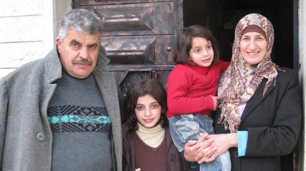 In the firing line ... Ibrahim Maklouf, his wife Khadra and youngest children Rua, 10, and Ruba, 4.