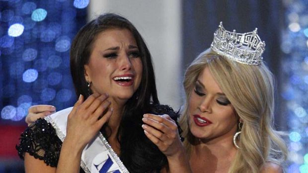 Tears of joy ... Laura Kaeppeler is crowned the winner by Miss America 2011 Teresa Scanlan.