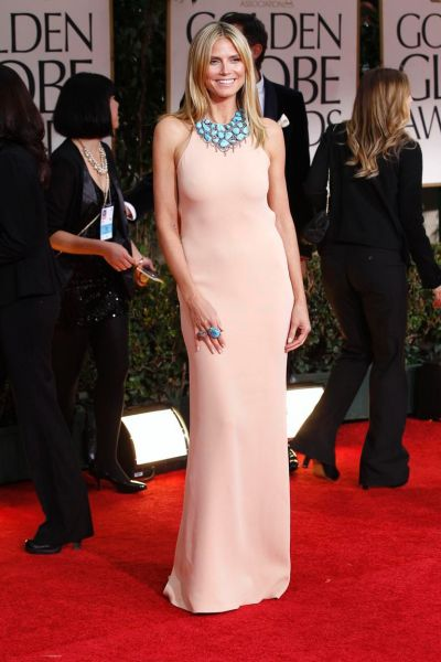 Model Heidi Klum poses as she arrives at the 69th annual Golden Globe Awards.