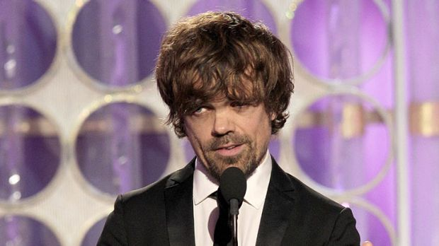 'Google him' ... Peter Dinklage accepts the Golden Globe for Best Supporting Actor yesterday.