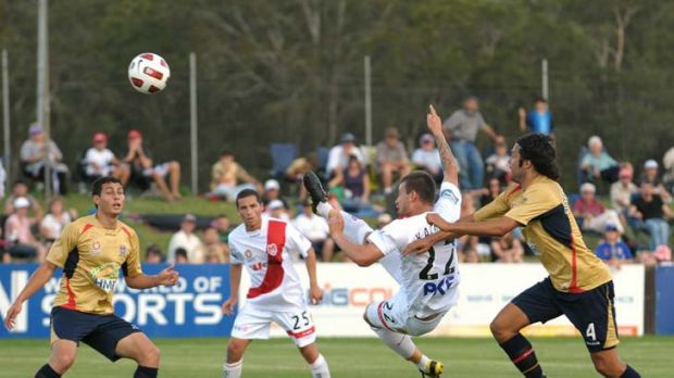 Community round ... the Heart's Nicholas Kalmar scores during the round 12 clash between Newcastle Jets and the ...