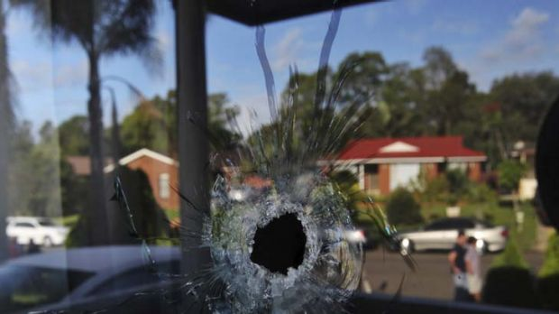 Yesterday's drive-by shooting, with the reflection of the homes of Coleridge Road in Wetherill Park.