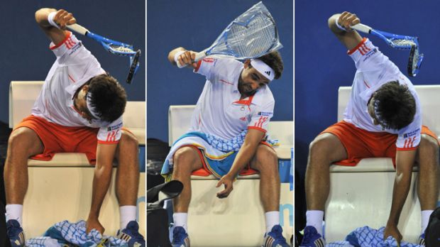 Getting smashed ... Cypriot Marcos Baghdatis unleashes on a series of racquets, including a brand new one he didn't even ...
