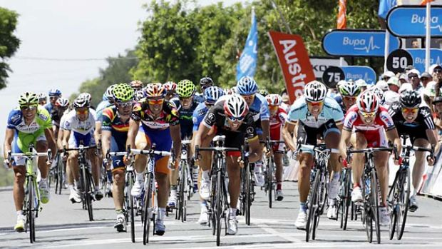 Close call: Oscar Freire (centre) narrowly wins yesterday's fourth stage of the Tour Down Under.