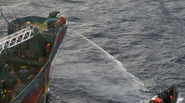 A water canon is sprayed from a Japanese whaling ship towards a small Sea Shepherd boat, about 480 km north of Mawson ...