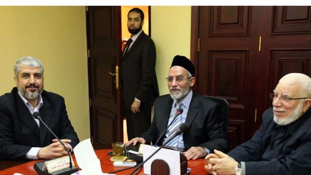 The leader of Hamas Khaled Meshaal, left, meets with Supreme Leader of the Muslim Brotherhood Mohamed Badie, centre, to ...