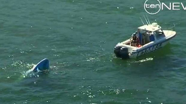 The boat appears to have partially sunk.