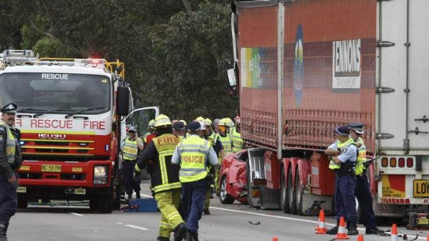 Loss … police and rescue staff investigate a crash on the Hume Highway, south of Sydney, after a semi-trailer ...