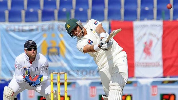 Misbah-ul Haq comes down the wicket to Monty Panesar as England wicketkeeper Matt Prior looks on at the Sheikh Zayed ...