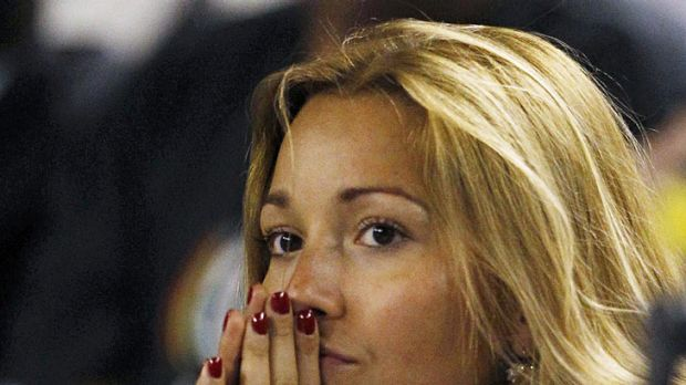 Djokovic's girlfriend Jelena Ristic watches on with concern from the player's box.