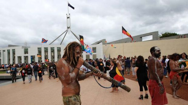 Protesters from the Aboriginal tent embassy on the forecourt of Parliament House in Canberra today.