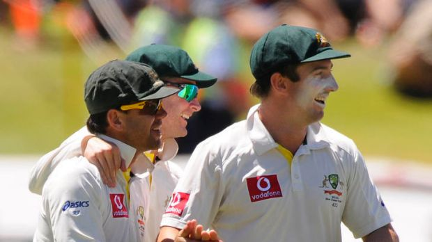 Ricky Ponting is congratulated by Michael Clarke and Shaun Marsh after catching a skied shot by Virender Sehwag.