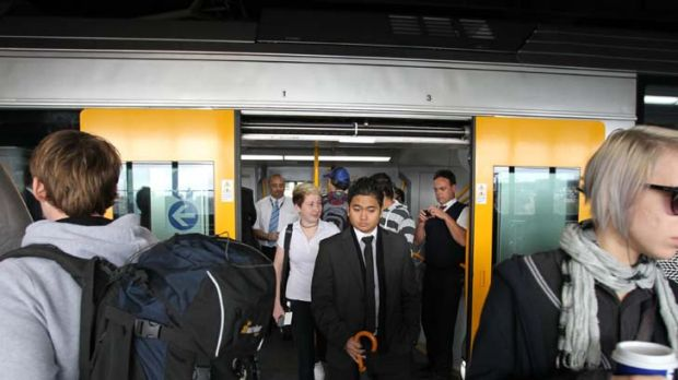 Delays ... passengers alight from a Waratah train at Circular Quay. The financially troubled project is 18 months behind ...