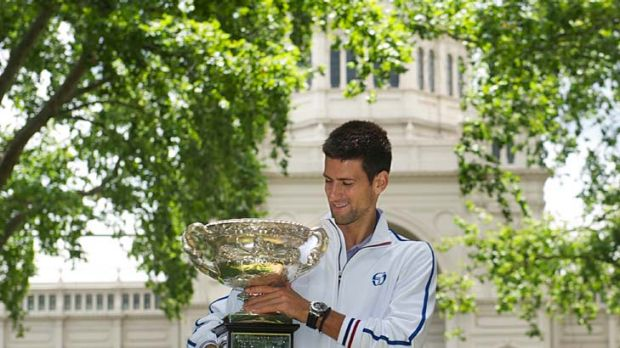 Novak Djokovic with his Australian Open trophy in Carlton Gardens: ''It was actually quite a good match.''